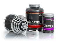 Creatine powder with scoop and dumbbell.Bodybuilder nutrition(supplement) concept.