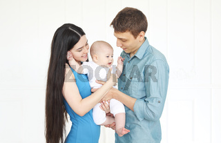 Young family with little son at home