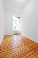small room, empty room with wooden board floor, white walls and window