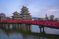 The Keep of Matsumoto Castle at twilight in Nagano, Japan