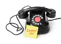 Vintage telephone and paper Contact us