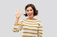 happy smiling woman showing five fingers