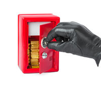 Hand and safe with gold bars