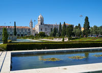 The view of Church of Santa Maria through the garden of Empire square. Lisbon, Portugal