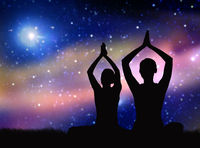 black silhouette of couple meditating over space