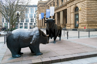Bull and bear sculpture in front of historic Frankfurt Stock Exchange building