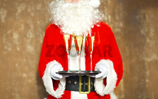 Santa Claus holding champagne glasses on the tray