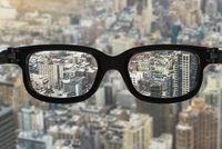 glasses focus cityscape