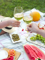 Young couple drinking wine outdoors