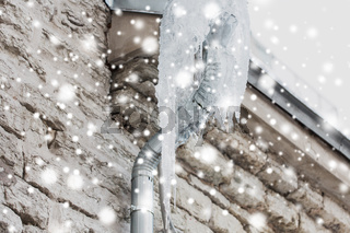 icicles hanging from building drainpipe
