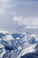 Sky gliding in winter mountains
