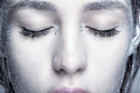 Female closed eyes. Closeup beauty portrait of young woman face