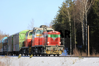 Two Diesel Engines in Front of Train