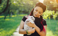 Pretty Asian Girl Hugging Bunny on Summer Nature