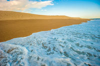 Yellow sand beach, sea and deep blue sky