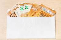fan from several fifty euro notes in open envelope