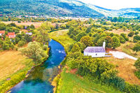 Stone church by Gacka river aerial view