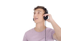 Smiling teen listening music with headphones