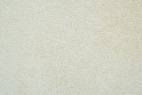 off-white or pale yellow roughcast plaster texture background wall