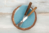 Old vintage cutlery and dishware food background.