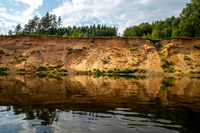Landscape with river, and trees on the cliff in Latvia.