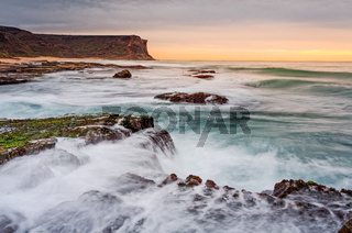 Waves and waterfalls coastal seascape
