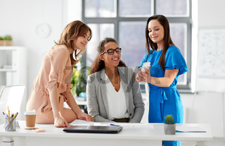 businesswomen with smartphone working at office