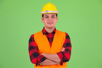 Young multi ethnic man construction worker with arms crossed