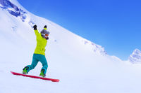 Snowboarder running down slope