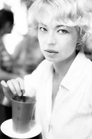 Lady With Cup of Coffee. Vintage black and white photo.