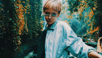Girl in tropical rain forest jungle