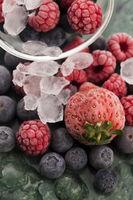 Closeup shot of frozen raspberries, blackberries and strawberries