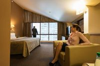 Business partners wait for meeting in hotel room
