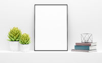 black picture frame mock up and green potted plants on white shelf