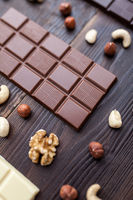 Delicious and sweet variety of chocolate on wooden background