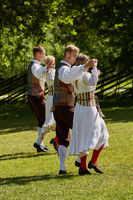 Local dancers and their traditional performance at the open air museum, Vabaohumuuseumi kivikulv, Rocca al Mare close to city of Tallinn in Estonia.