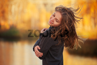 Young fashion girl in black pullover walking outdoor