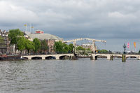View at Magere Brug, famous Dutch bridge in Amsterdam Canals