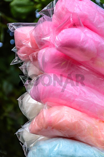 Bags with cotton candy of various colors