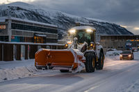 Powerful snowplough clearing residential roads