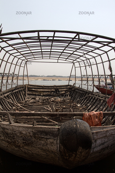 The boat stands in under a metal frame