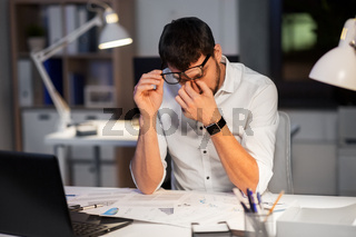 tired businessman working at night office