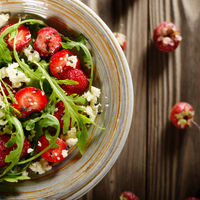 Strawberry arugula and feta cheese salad with chia seeds and sesame