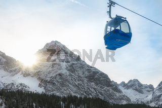 Cable car and snow-capped mountains