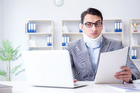 Businessman with neck injury working in the office