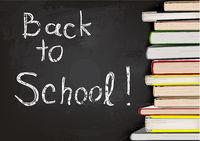 Back to School Written on Chalkboard with Books