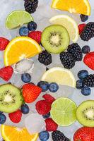 Fruits berry food background oranges strawberries ice cubes portrait format fresh fruit