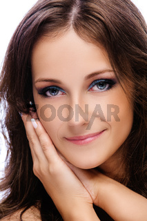 Portrait of a young smiling beautiful woman with dark hair