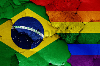 flags of Brazil and LGBT painted on cracked wall