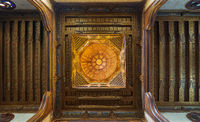 Wooden decorated dome mediating ornate ceiling with floral pattern decorations at Sultan al Ghuri Mausoleum, Cairo, Egypt